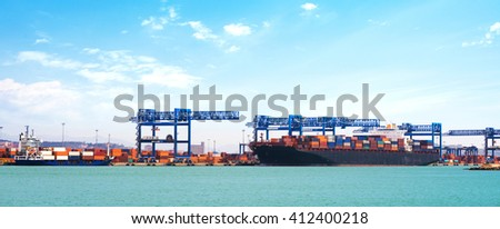 Cargo ship fully loaded with container stacks - stock photo