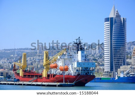 cargo ship in a port of Haifa - stock photo