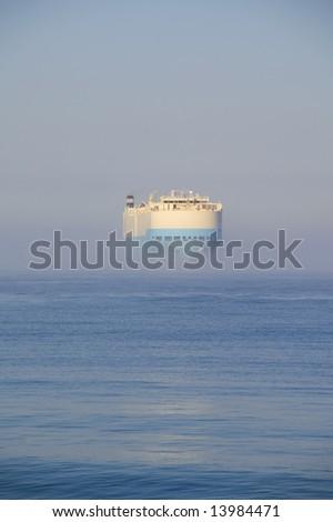 Cargo Ship in Fog - stock photo
