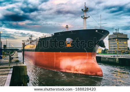 Cargo ship in harbor - stock photo