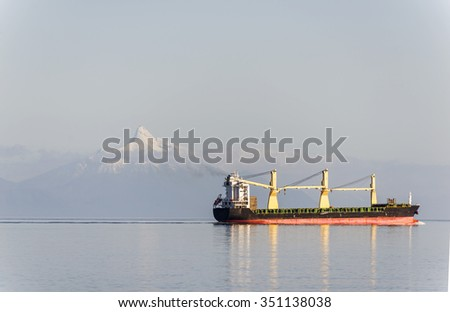 Cargo ship in ocean with mountain and snow on top Cruise travelling in South America, cargo ship cruise, transportation, Cruise travelling in South America, cargo ship cruise, transportation,