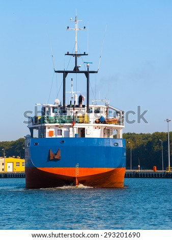 Cargo ship in port - rear view. - stock photo