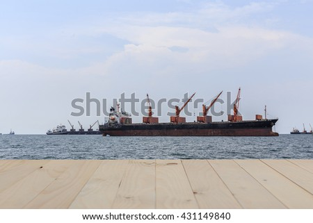 Cargo ship in sea Thailand.and table Can use for product display