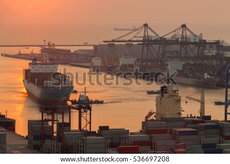 Cargo ship in the harbor at sunrise.