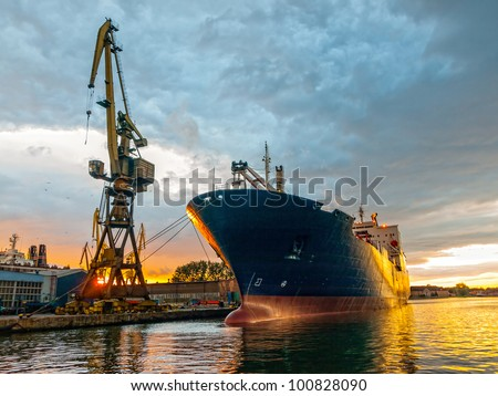 Cargo ship in the harbor at sunset. Gdansk, Poland. - stock photo