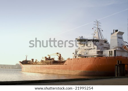Cargo ship in the Harbor of Amsterdam - stock photo