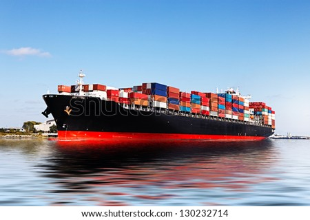 Cargo ship in the port - stock photo