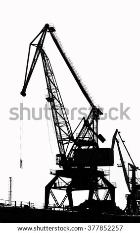Cargo ship-lifting cranes on the river  in the port (black-and-white photo)