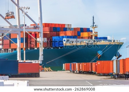 Cargo Ship Loading. Ocean Transportation Theme. Loading Cargo Containers. - stock photo
