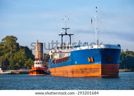 Cargo ship out of the harbor. - stock photo