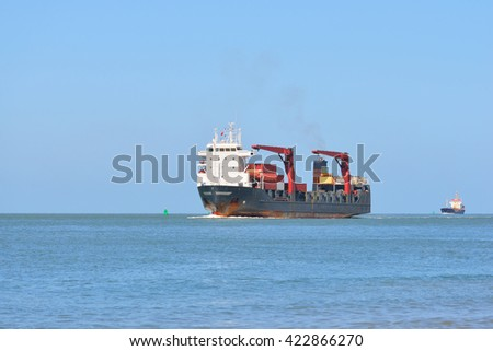 Cargo ship sailing in blue sea near to Vlissingen, the Netherlands - stock photo