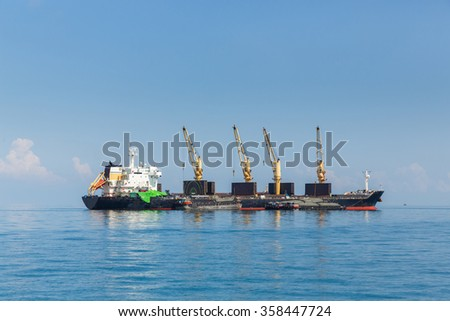 Cargo ship sailing in ocean, shipping business concept