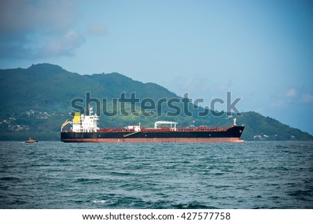 Cargo ship sailing in the Indian ocean near Seychelles islands