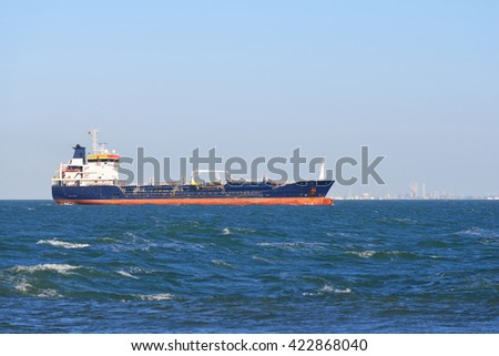 Cargo ship sailing in the sea by the coast of Vlissingen, the Netherlands - stock photo