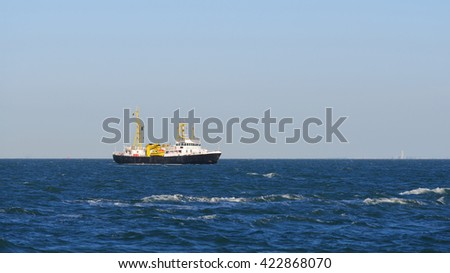 Cargo ship sailing in the sea in the Netherlands - stock photo