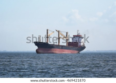 cargo ship sailing on the sea,blur effect