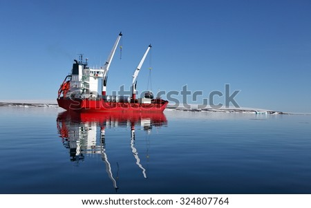 Cargo ship with cranes in Arctic - stock photo