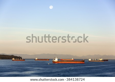 Cargo ships anchored in Burrard Inlet, the gateway of Vancouver city (British Columbia, Canada).