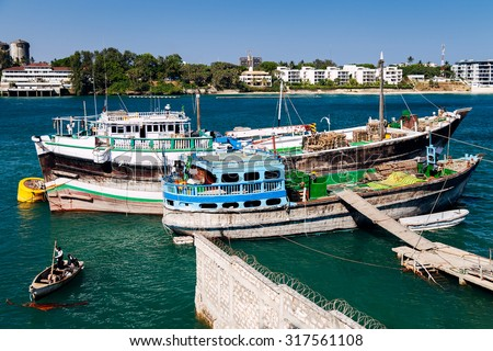 Cargo Ships In Mombasa, Kenya Near The Old Port On A Sunny Day - stock photo