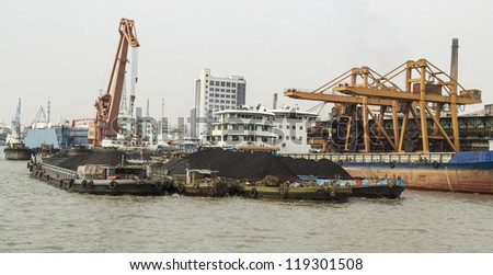 Cargo ships loaded with rare earth soil for export in China - stock photo