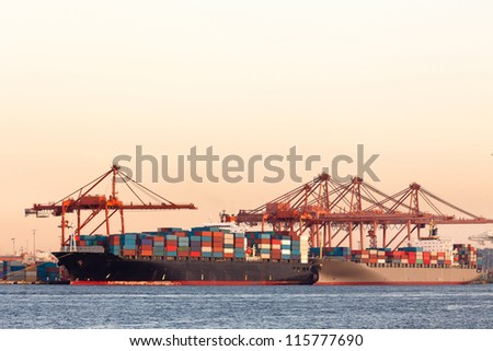Cargo ships with containers at port - stock photo