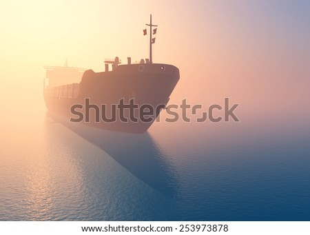 Cargo tanker at dawn in the mist. - stock photo