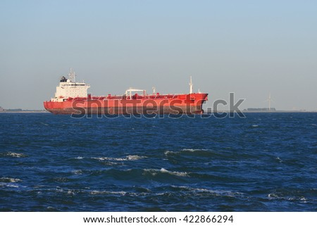 Cargo tanker ship sailing in blue sea near to Vlissingen, the Netherlands - stock photo