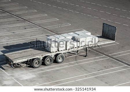 Cargo trailer stands on the parking of industrial terminal - stock photo