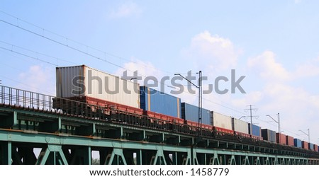 Cargo train crossing the bridge - stock photo