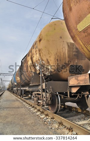 Cargo train of oil tank cars on the railway station - stock photo