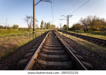 Cargo train platform at sunset. Railroad in Ukraine. Railway station - stock photo