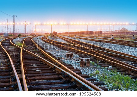 Cargo train platform at sunset with container - stock photo