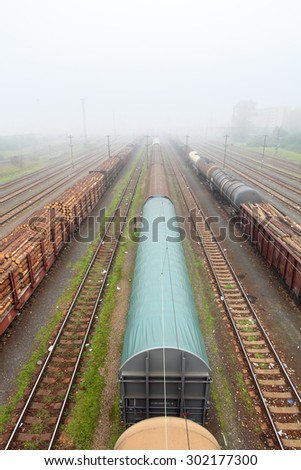 Cargo train platform with container, railway - stock photo