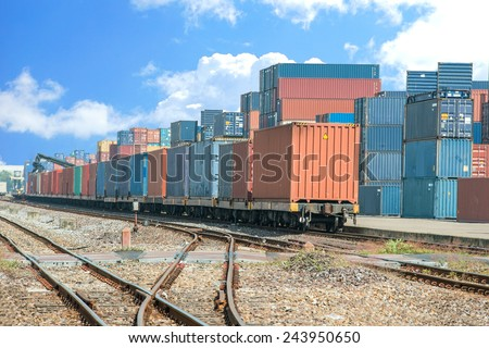 Cargo train platform with freight train container at depot - stock photo
