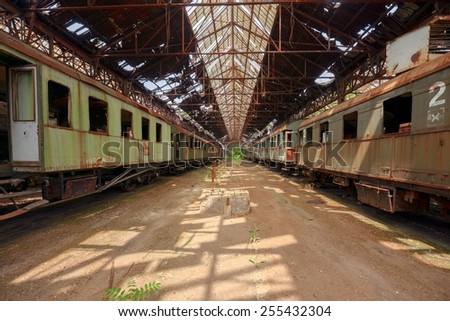 Cargo trains in old train depot eaten by rust - stock photo