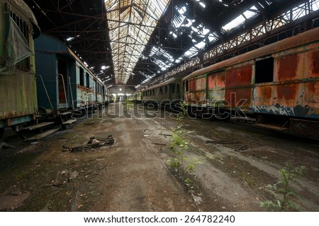Cargo trains in old train depot eaten by rust