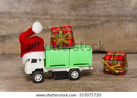 Cargo transport in the red cap have luck gifts for the New Year - stock photo