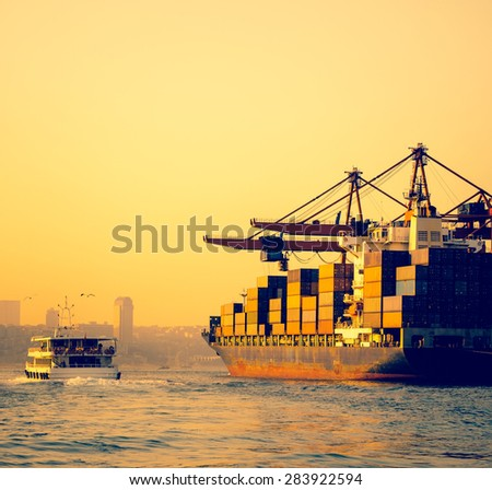 Cargo transportation in harbor - ship cranes and containers in a seaport. - stock photo