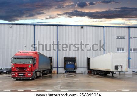 Cargo truck at warehouse building - stock photo