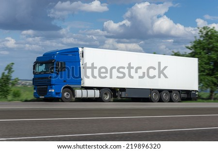 cargo truck go on road - stock photo