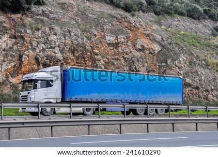 Cargo truck on the highway - stock photo