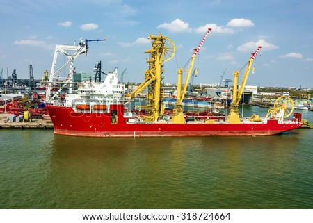 cargo vessel in sea port, Rotterdam, Netherlands. - stock photo