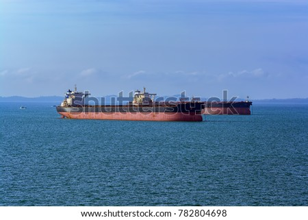 Cargo vessels anchored in the outer anchorage in anticipation of loading.