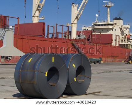 Cargo waiting to be loaded on a huge ship - stock photo