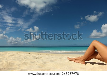 caribbean holidays background with blue sea and women legs