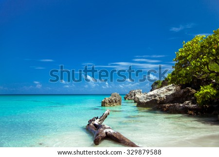 Caribbean island. Beautiful uninhabited island in the Caribbean Sea. The beautiful nature, incredible scenery. The sea breeze. Tropical Island Paradise. tropical beach with turquoise water - stock photo