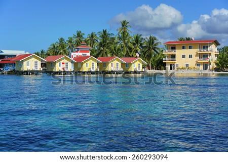Caribbean resort with cabins over the water, Carenero island, Bocas del toro, Panama, Central America - stock photo