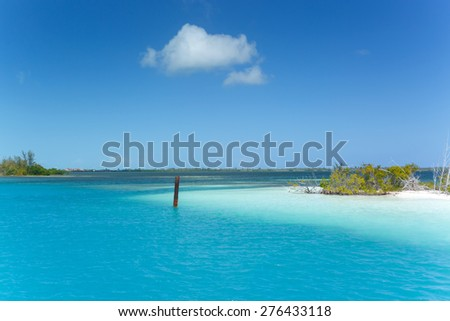 Caribbean sea in turquoise color and lonely island - stock photo