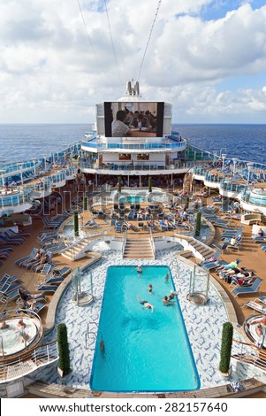 CARIBBEAN SEA - JANUARY 30, 2015: Passengers enjoy a day at sea on the top deck of the Royal Princess cruise ship during a cruise in the West Indies.