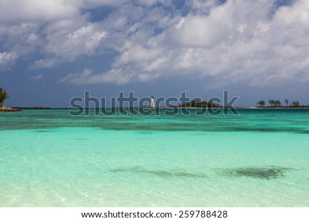 Caribbean seascape with distant lighthouse at Nassau, Bahamas. - stock photo